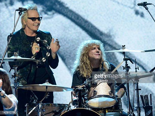 Inductees Matt Sorum and Steven Adler of Guns N' Roses perform on stage at the 27th Annual Rock And Roll Hall Of Fame Induction Ceremony at Public...