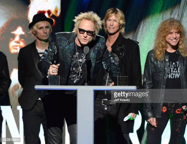 Inductees Matt Sorum Duff McKagan and Steven Adler of Guns N' Roses speak on stage at the 27th Annual Rock And Roll Hall Of Fame Induction Ceremony...