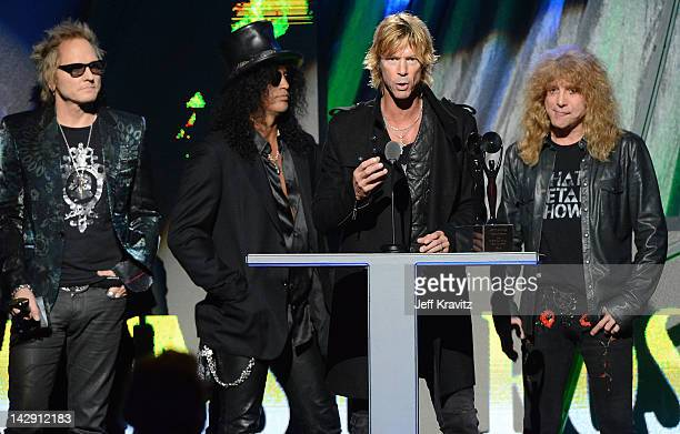 Inductees Matt Sorum Slash Duff McKagan and Steven Adler of Guns N' Roses on stage at the 27th Annual Rock And Roll Hall Of Fame Induction Ceremony...