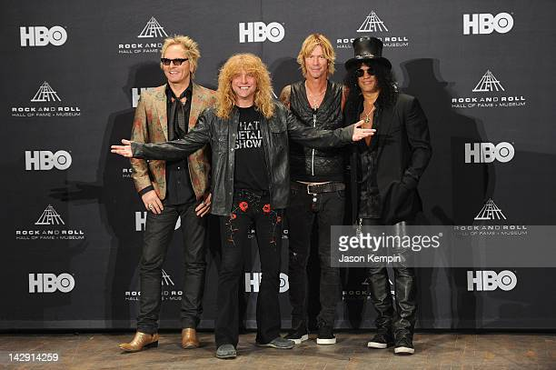 Inductees Matt Sorum Steven Adler Duff McKagan and Slash of Guns N' Roses pose in the press room during the 27th Annual Rock And Roll Hall Of Fame...