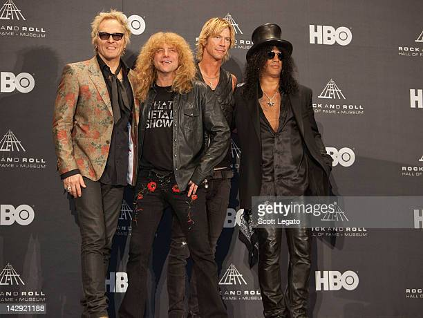 Inductees Matt Sorum Steven Adler Duff McKagan and Slash of Guns N' Roses pose in the press room duringthe 27th Annual Rock And Roll Hall Of Fame...