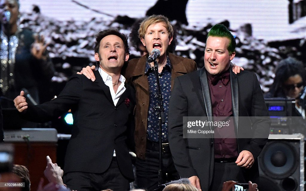 Inductees Mike Dirnt (L) and Tre Cool (R) of Green Day perform with Beck onstage during the 30th Annual Rock And Roll Hall Of Fame Induction Ceremony at Public Hall on April 18, 2015 in Cleveland, Ohio.