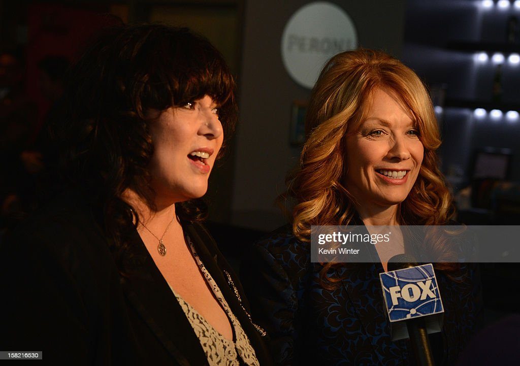 Inductees Nancy Wilson (L) and Ann Wilson (R) of 'Heart' are interviewed during the press conference for the Rock and Roll Hall of Fame 2013 Inductees announcement at Nokia Theatre L.A. Live on December 11, 2012 in Los Angeles, California.
