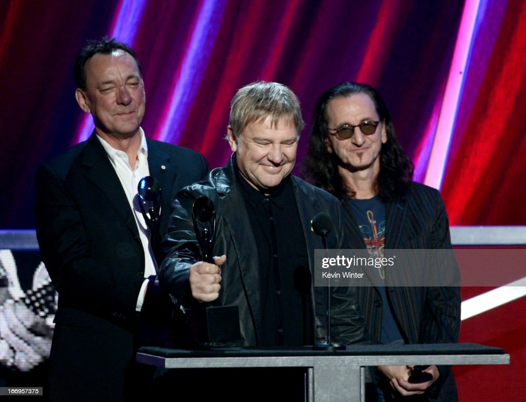 Inductees Neil Peart, Alex Lifeson and Geddy Lee of Rush speak on stage at the 28th Annual Rock and Roll Hall of Fame Induction Ceremony at Nokia Theatre L.A. Live on April 18, 2013 in Los Angeles, California.