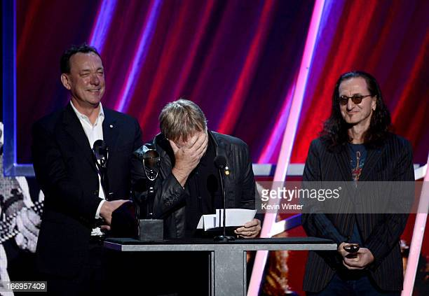 Inductees Neil Peart Alex Lifeson and Geddy Lee of Rush speak on stage at the 28th Annual Rock and Roll Hall of Fame Induction Ceremony at Nokia...