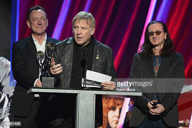Inductees Neil Peart Alex Lifeson and Geddy Lee speak onstage during the 28th Annual Rock and Roll Hall of Fame Induction Ceremony at Nokia Theatre...