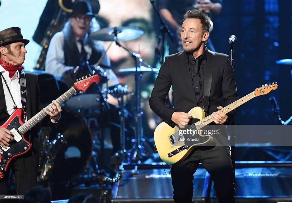 Inductees Nils Lofgren and Vini Lopez of the E Street Band perform onstage with Bruce Springsteen at the 29th Annual Rock And Roll Hall Of Fame Induction Ceremony at Barclays Center of Brooklyn on April 10, 2014 in New York City.