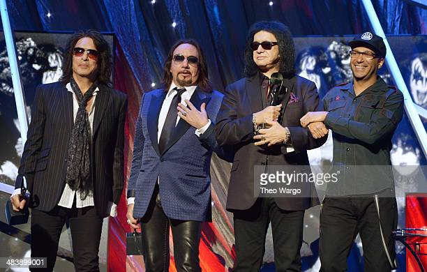 Inductees Paul Stanley Ace Frehley and Gene Simmons of KISS and musician Tom Morello pose onstage at the 29th Annual Rock And Roll Hall Of Fame...