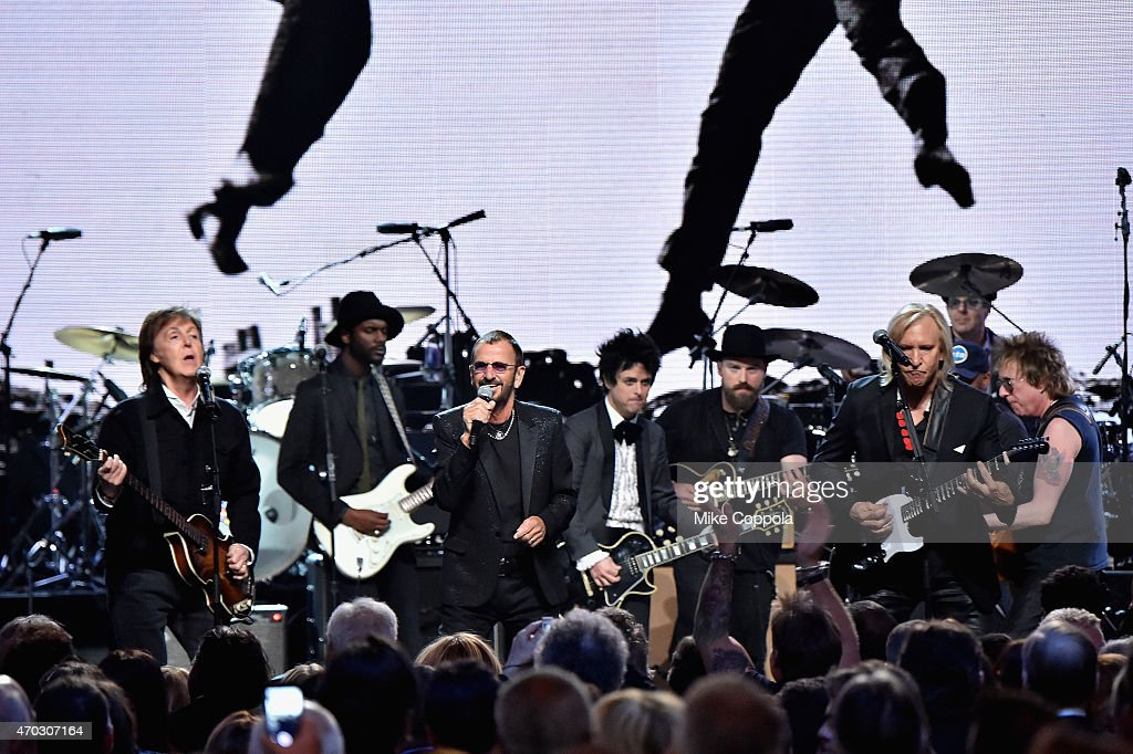 Inductees Ringo Starr and Billie Joe Armstrong of Green Day perform with Sir Paul McCartney Gary Clark Jr Zac Brown and Joe Walsh onstage during the...