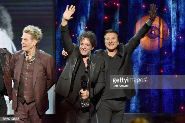 Inductees Ross Valory Neal Schon and Steve Perry of Journey onstage at the 32nd Annual Rock Roll Hall Of Fame Induction Ceremony at Barclays Center...