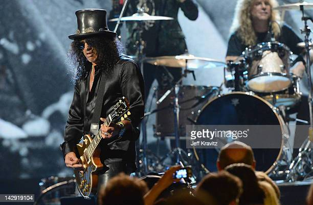 Inductees Slash and Steven Adler of Guns N' Roses perform on stage at the 27th Annual Rock And Roll Hall Of Fame Induction Ceremony at Public Hall on...
