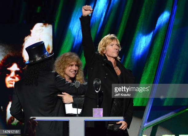 Inductees Slash Steven Adler and Duff McKagan of Guns N' Roses speak on stage at the 27th Annual Rock And Roll Hall Of Fame Induction Ceremony at...