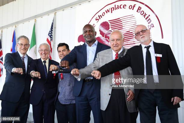 Inductees Steve Farhood Barry Tompkins Marco Antonio Barrera Evander Holyfield Jerry Roth and Johnny Lewis pose with their Hall of Fame rings during...