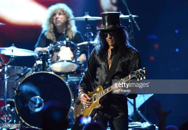 Inductees Steven Adler and Slash of Guns N' Roses perform on stage at the 27th Annual Rock And Roll Hall Of Fame Induction Ceremony at Public Hall on...