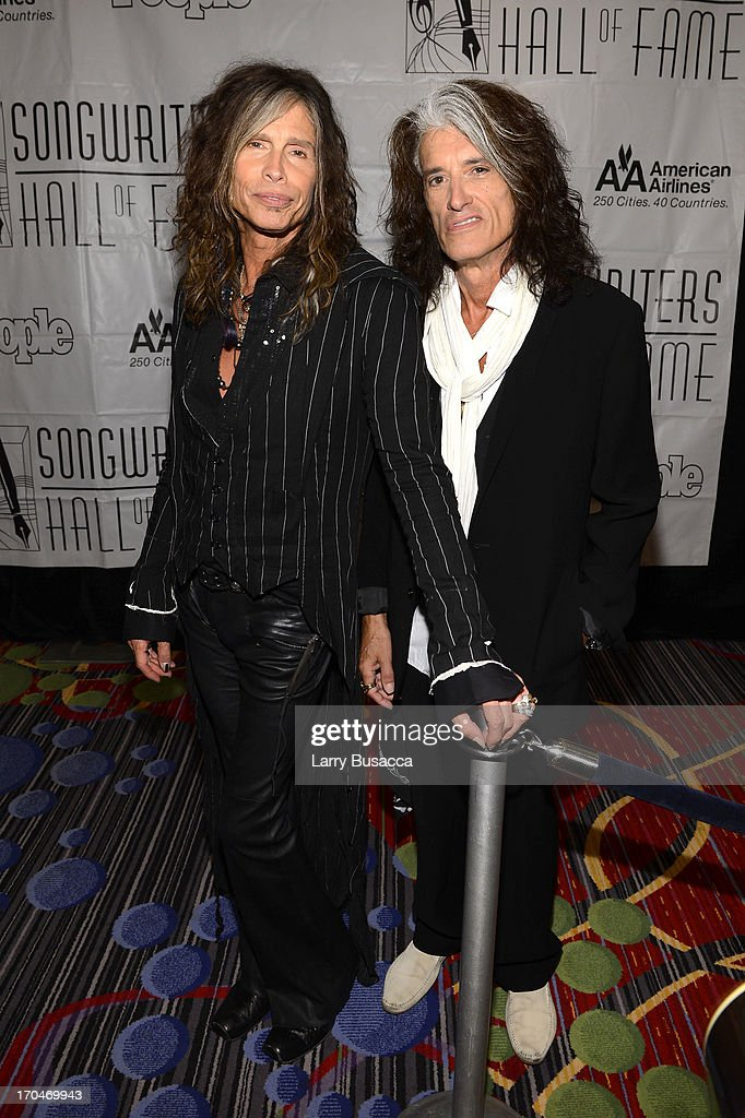 Inductees <a gi-track='captionPersonalityLinkClicked' href=/galleries/search?phrase=Steven+Tyler+-+Musician&family=editorial&specificpeople=202080 ng-click='$event.stopPropagation()'>Steven Tyler</a> and <a gi-track='captionPersonalityLinkClicked' href=/galleries/search?phrase=Joe+Perry+-+Musician&family=editorial&specificpeople=13600677 ng-click='$event.stopPropagation()'>Joe Perry</a> of Aerosmith attend the Songwriters Hall of Fame 44th Annual Induction and Awards Dinner at the New York Marriott Marquis on June 13, 2013 in New York City.