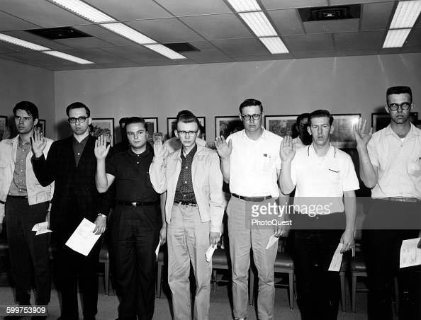 Inductees taking the oath as they are sworn into the Army March 6 1965 They have just completed their physical exams and will leave for Fort Leonard...