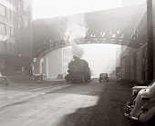 Locomotive on the street in depression era Cincinnati, Ohio