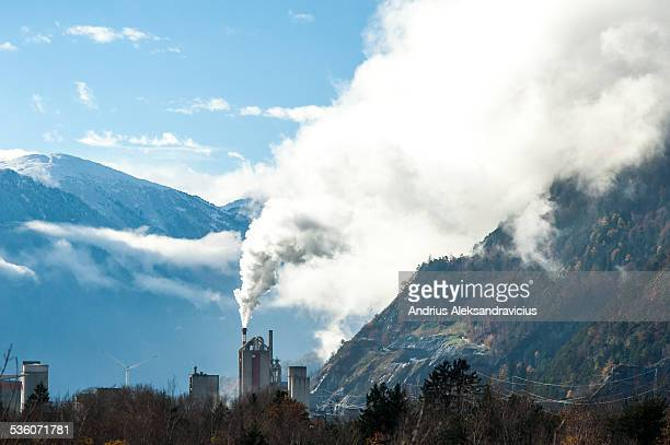 Industrial building with smoke from the chimney Switzerland 16 November 2014