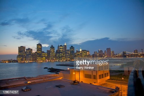 industrial buildings and rooftops of shoreline brooklyn heights with office towers of lower manhattan brooklyn industrial office