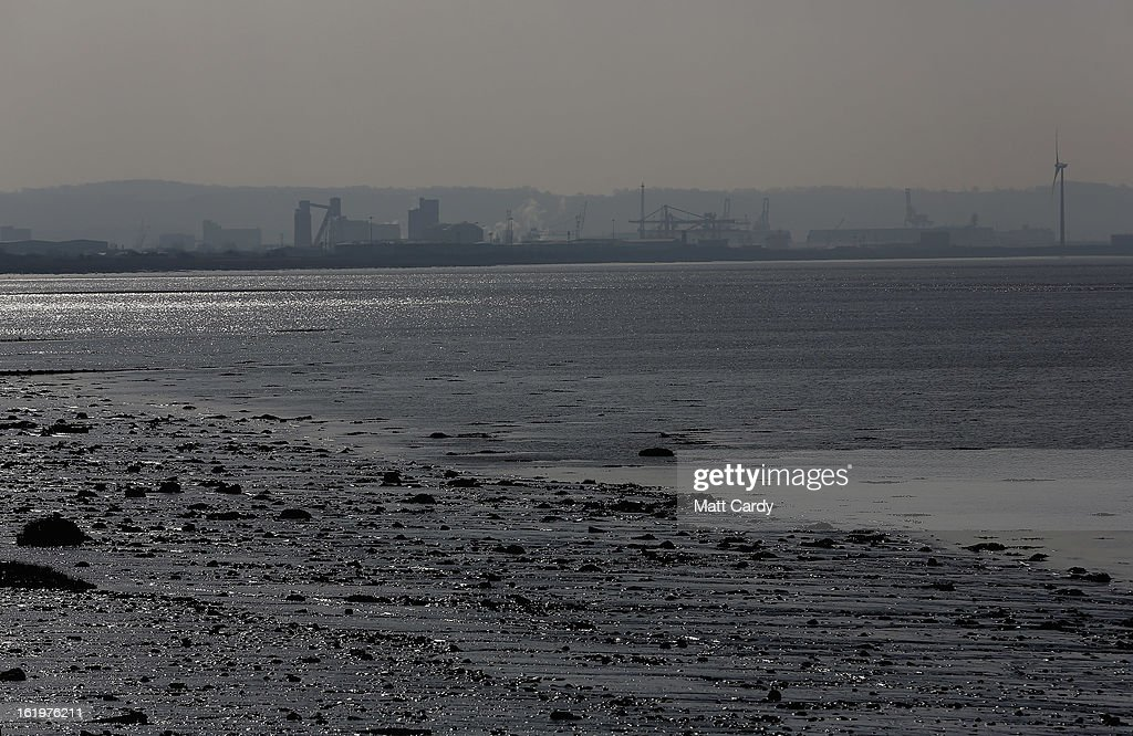 Industrial buildings besides the Severn Estuary at Avonmouth pictured from Severn Beach on February 18, 2013 near Bristol, England. Bristol elected mayor, George Ferguson, has recently claimed that the proposed 30bn GDP Severn barrage could have a detrimental impact on the regional economy if it goes ahead, but supporters of the project claim it could provide 5 percent of the UK's electricity and create thousands of jobs.