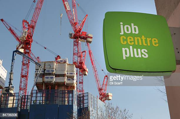 Industrial cranes on a construction site stand in the background beyond a sign outside a branch of the Job Centre Plus on February 11 2009 in London...