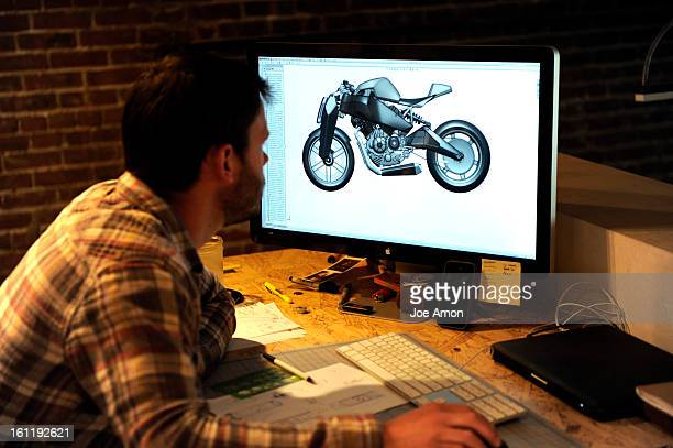 Industrial designer Dustin Griffith 26 looking over the design for the next prototype to a superbike they call the Ronin in their shop in Denver...