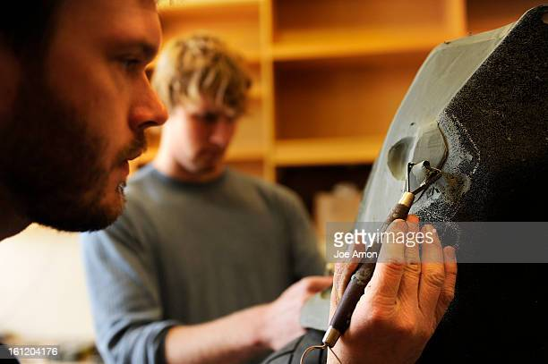Industrial designer Dustin Griffith and Shane Korthuis work on changes for the front cowling of the Ronin a superbike this group of designers and...