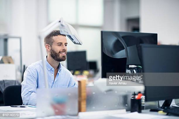 Industrial designer working at computer in office