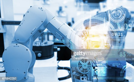 Industrial internet of things and industry 4.0 concept. Abstract blue background of technology graphic and automation wireless control robotic machine in smart factory with flare light effect. : Foto de stock