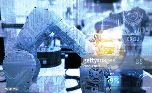 Industrial internet of things and industry 4.0 concept. Abstract blue background of technology graphic and automation wireless control robotic machine in smart factory with flare light effect. : Stock Photo