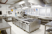 Industrial kitchen with cooking utensils.