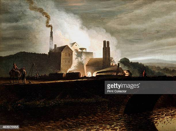 Industrial landscape Wales 19th century An ironworks at night the blast furnace in the centre