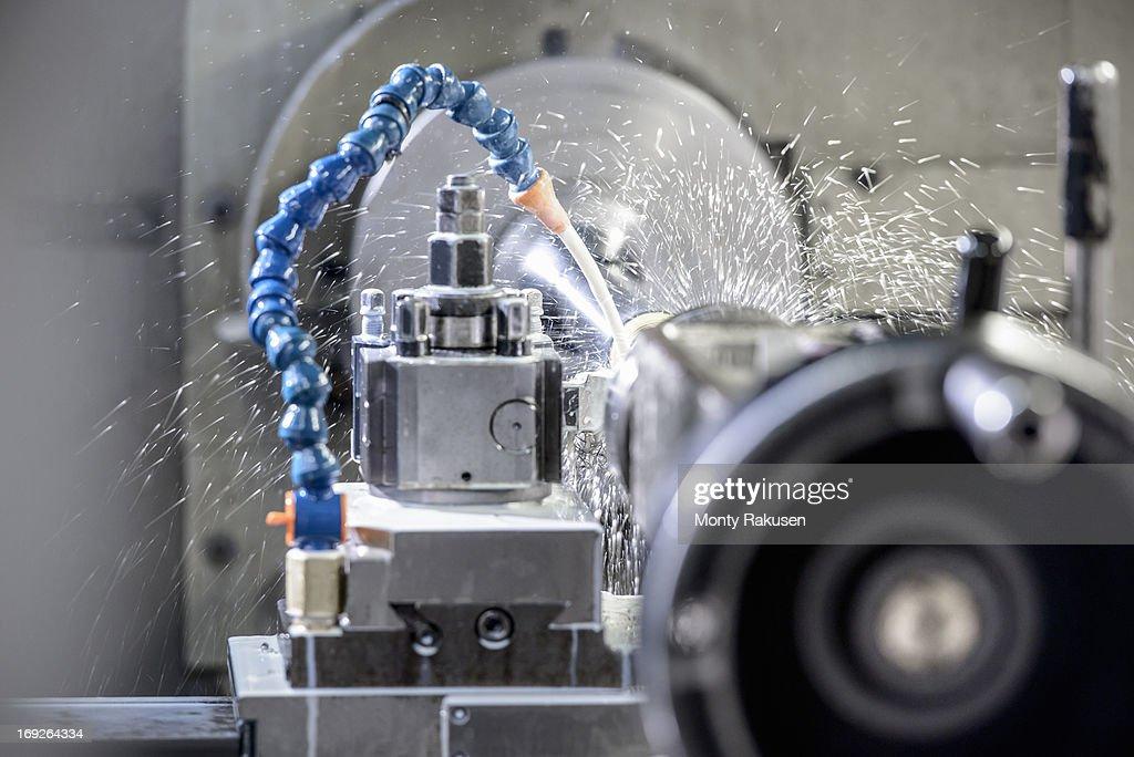 Industrial lathe cutting steel in engineering factory