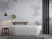 Industrial loft style bathroom 3d render,There are white brick wall and polished concrete floor decorate with black steel tube,Furnished wood furniture.