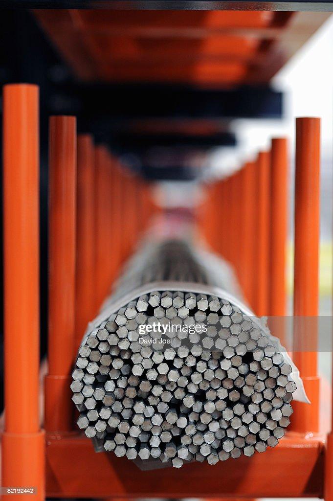 Industrial metal bars bundled on rack