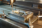 Industrial metal mold milling. Metalworking. CNC industry