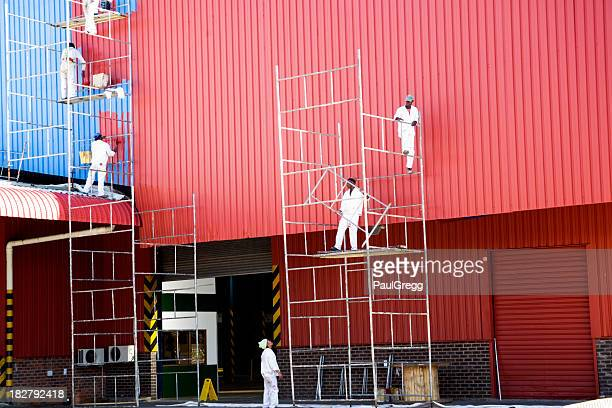Industrial painters painting factory