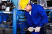 professional industrial repairman using wrench
