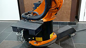 Industrial robotics robot arm for welding and assembling with three dimensional 3d freedom movement. Modern technology concept.