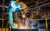 Industrial robot is test run welding in car factory