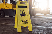 Sign showing warning of caution forklifts at industrial for safety.