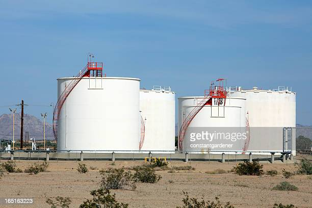 Industrial Storage Tanks With Red Stairs