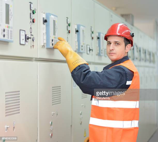 Industrial technician operating in power substation