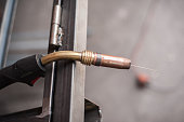 Industrial tool for welding the steel structure. Close up