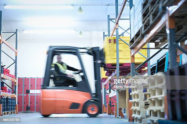 Industrial training with forklift truck in warehouse