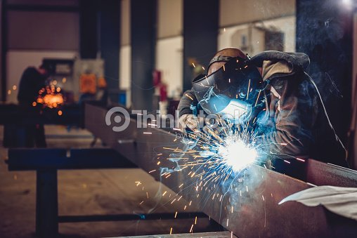 Industrial Welder With Torch : Stock-Foto