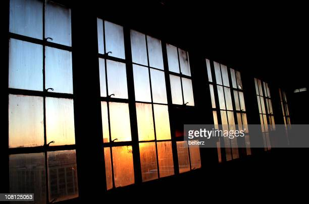 Industrial Window Pane with Sunset Shining Through