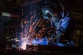 Industrial Worker at the factory welding closeup