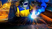 Industrial Worker in action welding close up