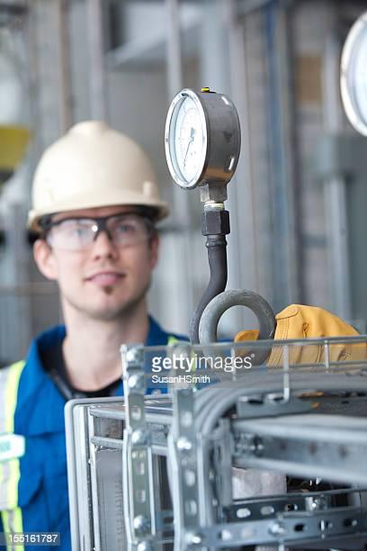 Industrial Worker looking at gauge